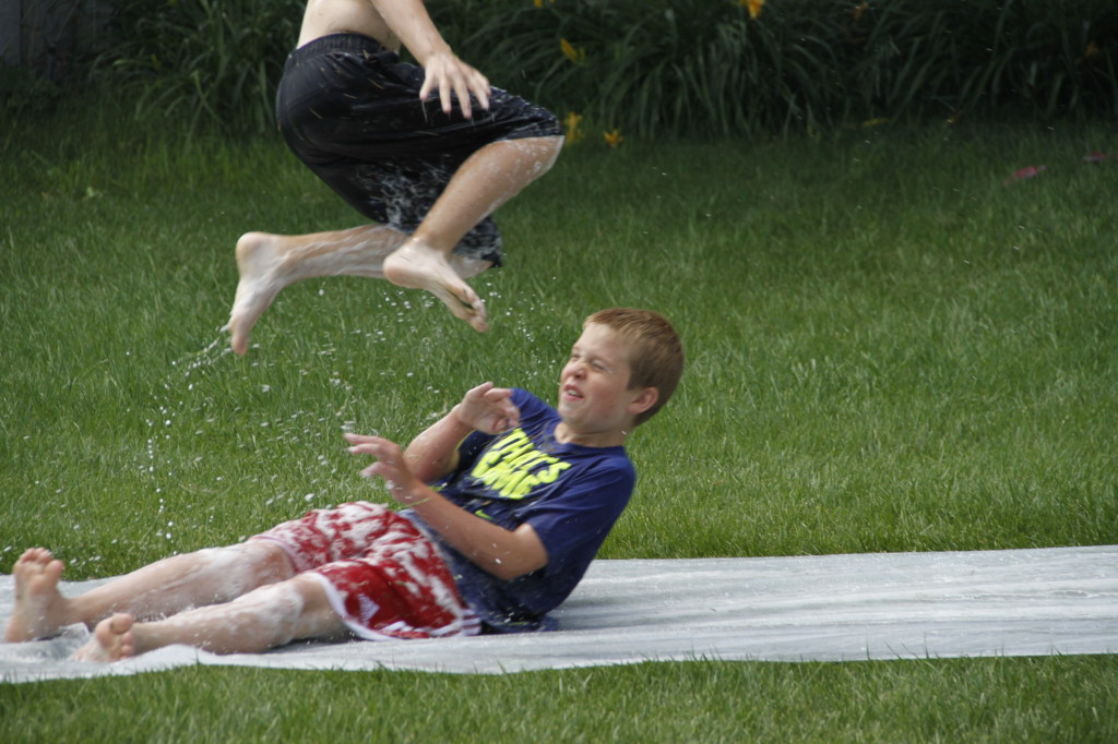 slip n slide leap over head Hayden Pete