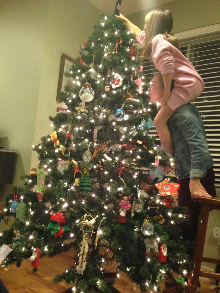 putting the star on the Christmas tree 2014