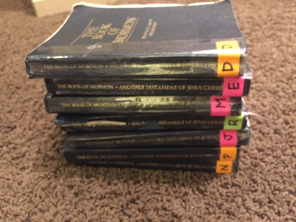 stack of copies of the Book of Mormon