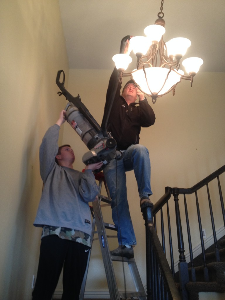 vacuuming out the light fixture