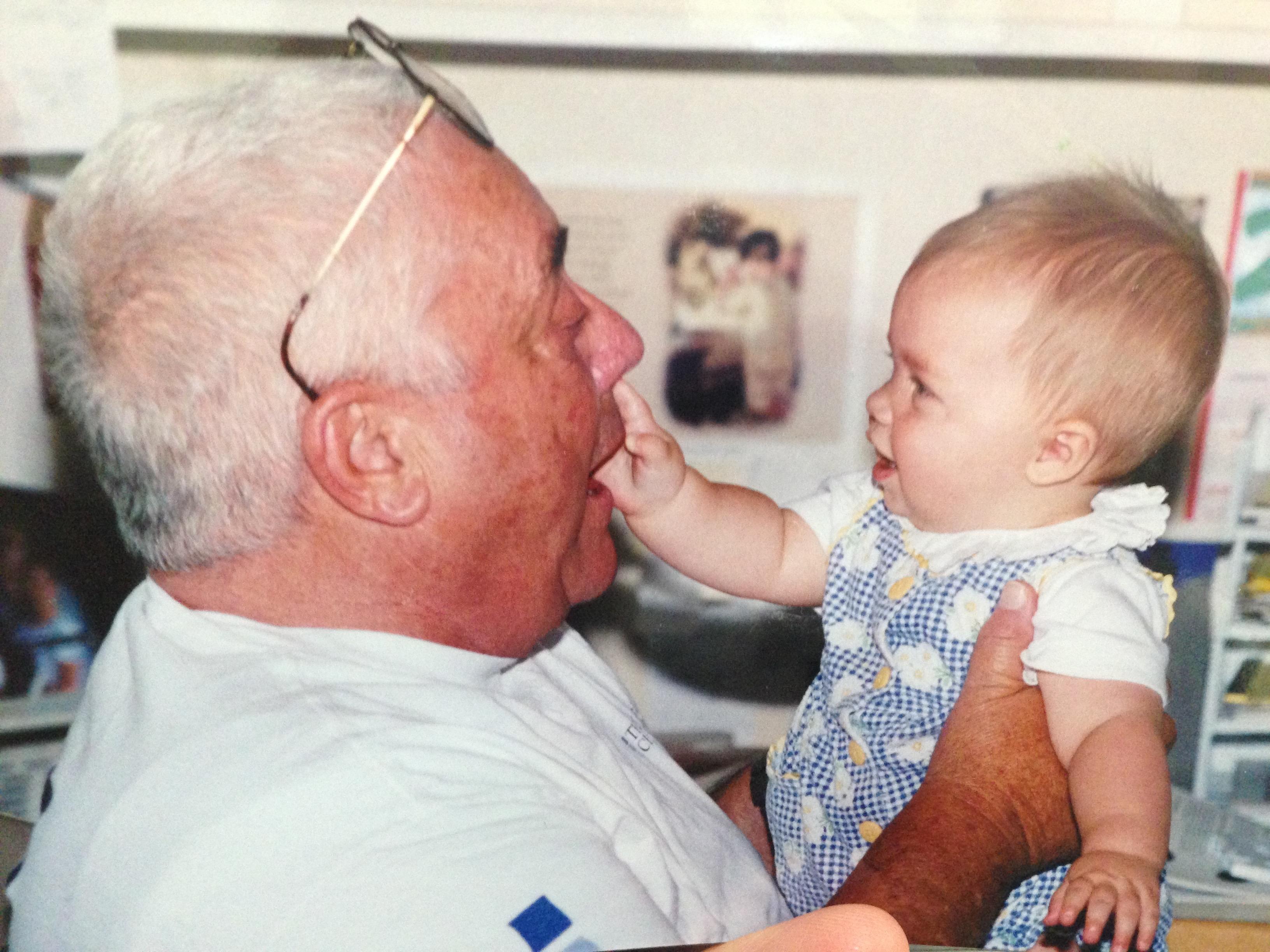 Grandpa McConochie and baby Rebecca