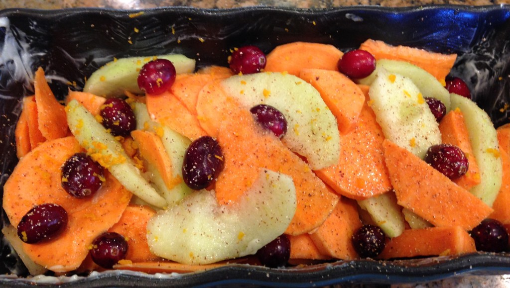 This dish is so easy to make. Simply peel and slice Granny Smith apples and some yams. Put fresh cranberries on top. Pour a little agave syrup on top and sprinkle with freshly ground (or not) cinnamon and nutmeg. A touch of salt finishes things off. (Fresh lemon zest doesn't hurt, either.) Bake at, well, say 375℉ for I'm not sure how long. It depends on how much you made! Better check on it after 30 minutes or when you start to smell good smells from the oven (if you are in the same room!).