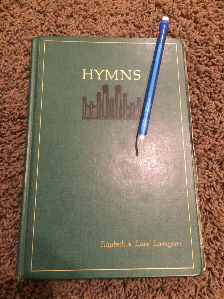 hymn book with pencil
